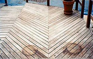A dirty weathered Wolmanized pine deck
